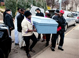 People carry the casket of Ramadhan Mohamed on Sunday.