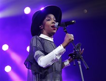 "Lauryn Hill performs at Amnesty International's ""Bringing Human Rights Home"" concert in New York in February 2014."