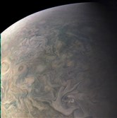 This Dec. 11, 2016, image made available by NASA shows Jupiter's northern latitudes made by the spacecraft Juno as it performed a close flyby of the gas giant planet.