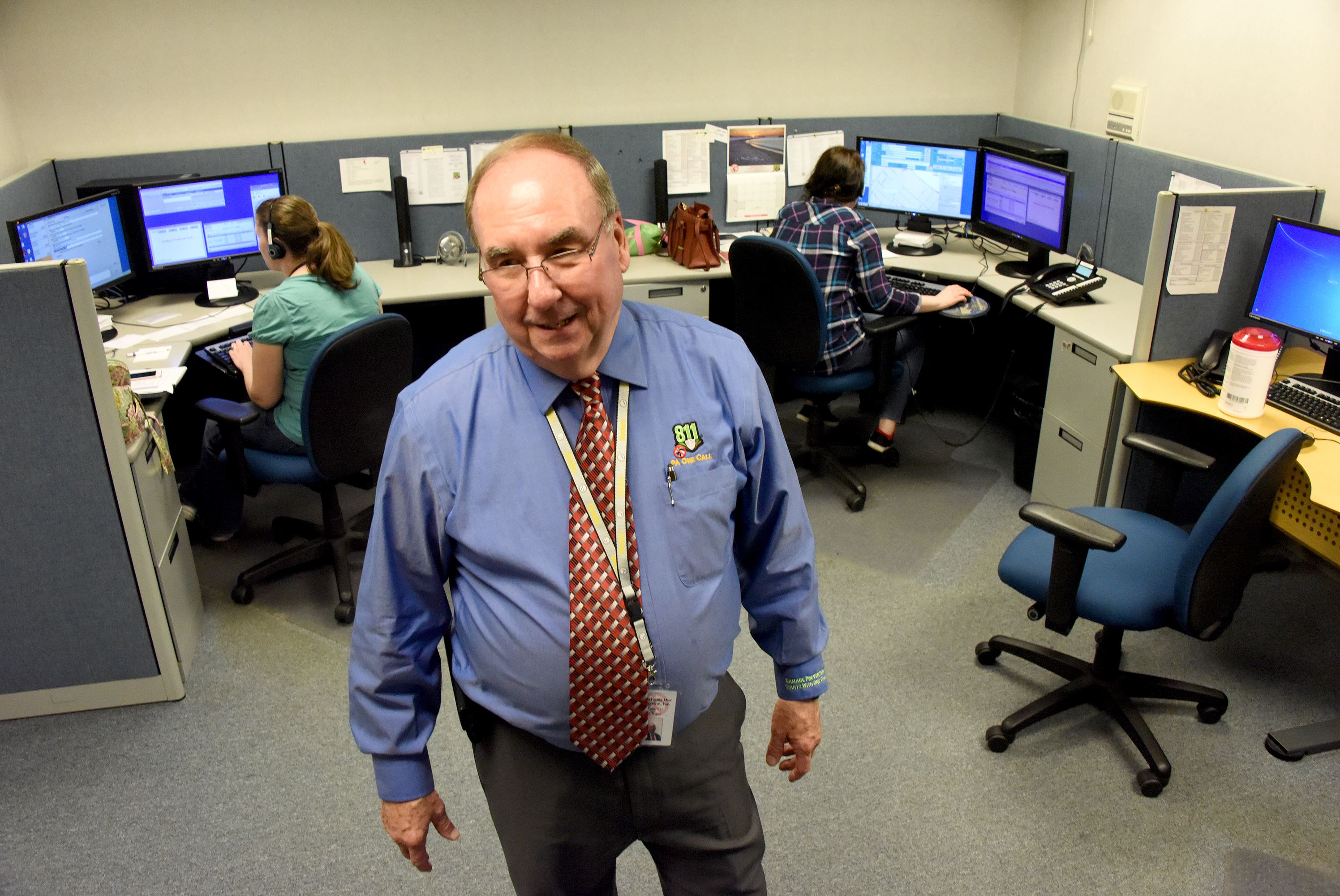 20170224dsTop50ONECALL0526Biz05-4 Director Bill Kiger walks through the 24 hour service area of Pennsylvania One Call System Inc., located in West Mifflin. Bill has been with the Call Center for 42 years.