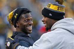 Receiver Antonio Brown is publicly urging teammate Le'Veon Bell to sign his franchise player tender with the Steelers.