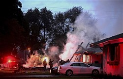 Smoke rises from a fire after a plane crashed in Riverside, Calif., Monday. The deadly crash injured several when a small plane collided with two homes Monday shortly after taking off from a nearby airport, officials said.