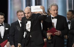"""La La Land"" producer Jordan Horowitz holds up the correct card announcing the Oscar for Best Picture, ""Moonlight,"" at Sunday night's Academy Awards ceremony."