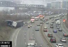 A tractor trailer is seen off the shoulder of the Parkway East, at left, after crashing Tuesday morning.