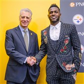 Antonio Brown shakes hands with Art Rooney II after a news conference about his five-year, $72.71 million contract Monday on the South Side.