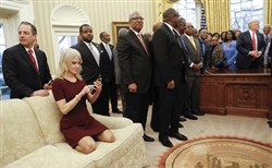 President Donald Trump, right, meets with leaders of Historically Black Colleges and Universities in the Oval Office of the White House Monday. Also at the meeting are White House Chief of Staff Reince Priebus, left, and Counselor to the President Kellyanne Conway, on the couch.