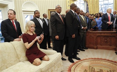 Kellyanne Conway sparks debate after kneeling on Oval Office couch