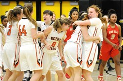 Bethel Park players celebrate after defeating Penn Hills in the WPIAL Class 6A semifinal game Feb. 28 at North Allegheny.