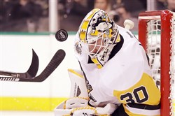 Penguins' Matt Murray makes a save against the Dallas Stars in the first period at American Airlines Center on February 28 in Dallas, Texas.