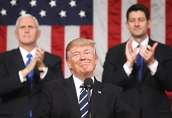 President Donald Trump delivers his first address to a joint session of the U.S. Congress Tuesday night as Vice President Mike Pence, left, and Speaker of the House Paul Ryan, R-Wisc., look on.
