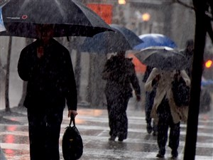 Pittsburghers trudge through a downpour Wednesday morning along Centre Avenue in Downtown Pittsburgh.