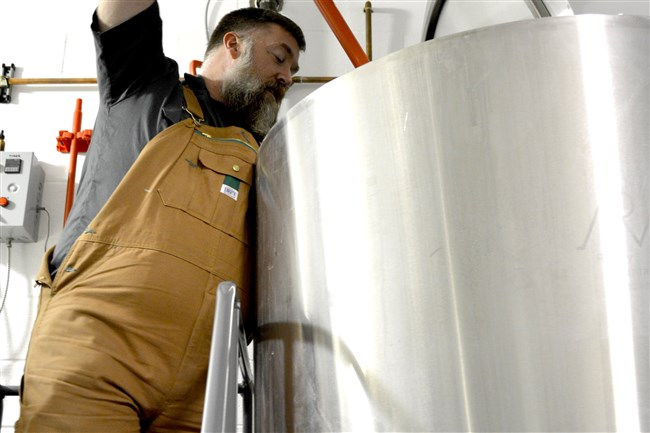 Tim Bauer helps with a brew this week at Cellar Works Brewing Co.