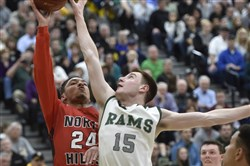 Pine-Richland's Evan Luellen blocks a shot by Kamron Taylor of North Hills during a game March 1 at North Allegheny.