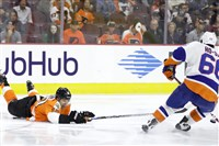 The New York Islanders' Josh Ho-Sang, right, battles for the puck with Philadelphia's Brayden Schenn during a preseason game in Philadelphia.
