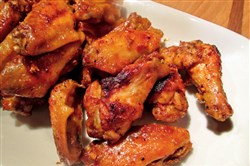 Spicy Asian Wings:  The sauce is a combo of fresh ginger, ketchup, brown sugar and a hit of sriracha, adding a mix of heat and sweet to these wings.
