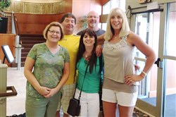 Author Niki Kapsambeli with, from left, siblings Karla (DeMoe) Hornstein and Dean DeMoe and their spouses Matt Hornstein and Deb DeMoe. Dean carries the DeMoe family's Alzheimer's gene but has yet to show symptoms from it.