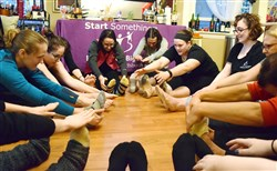 Kaitlin Mausser, at right wearing black headband, leads a ballet class at her Ross home that was a fundraiser for Big Brothers Big Sisters of Greater Pittsburgh.