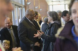 Sala Udin, center left, is running for a seat on the Pittsburgh school board.