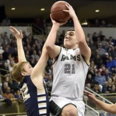 Pine-Richland's Andrew Kristofic gets a shot up against Butler's Jace Stutz in the WPIAL Class 6A championship Saturday at Petersen Events Center.
