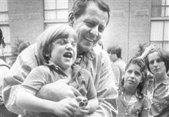 Dr. Thomas Starzl hugs Todd McNeeley, 4, of Darien, Conn., at a party given for him by liver transplant patients June 19, 1983.