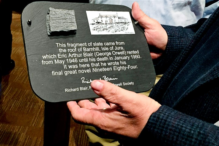"BlairSlate.jpg A plaque containing a piece of the roof from the house where George Orwell wrote the dystopian novel ""1984"" was given to Prime Stage Theatre, which opened its 20th season with play adaptation of ""1984"" Saturday at the New Hazlett Theater on the North Side."
