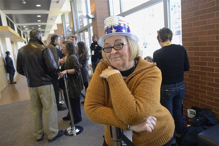 20170305lrdemocratsendorse13-12 Cynthia Falls, from District 7 and who is running for aschool board seat, waits to talk as members of the Allegheny County Democratic Committee gathered at the IBEW Hall on the South Side on Sunday.