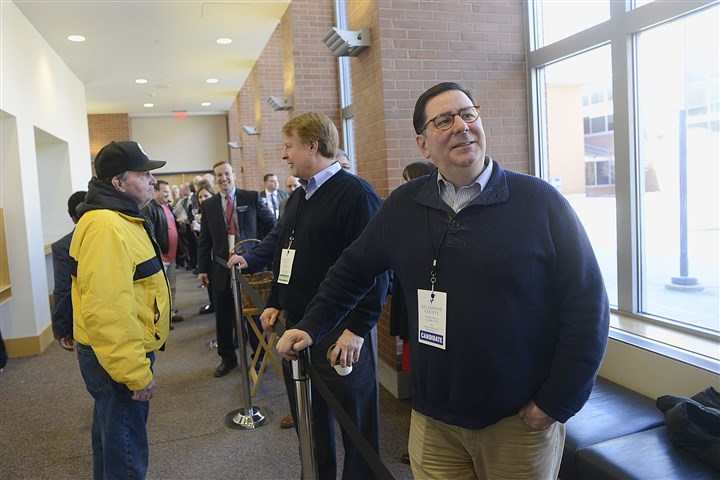 20170305lrdemocratsendorse16 Pittsburgh Mayor William Peduto, right, watches the crowd file in as as County Executive Rich Fitzgerald talks with someone coming down the line of candidates as members of the Allegheny County Democratic Committee gathered at the IBEW Hall on the South Side on Sunday to cast their ballots for which candidates the party will endorse in the next election.