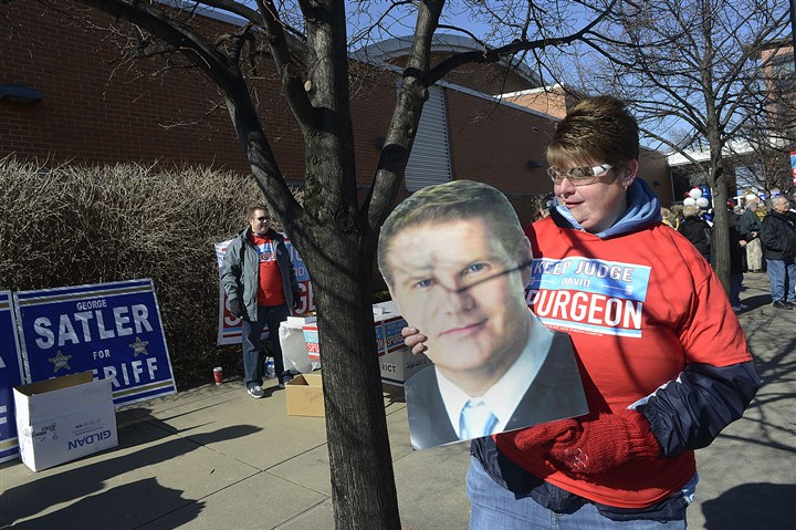 20170305lrdemocratsendorse09-8 Christine Szymarek of White Oak stands outside the IBEW Hall on the South Side holding a photo of David Spurgeon, a childhood friend who is running for judge.