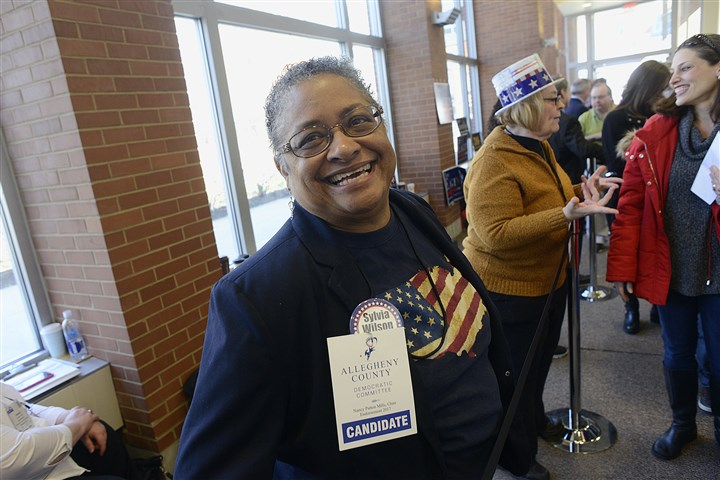 20170305lrdemocratsendorse14-13 Sylvia C. Wilson, left, who is running for the District 1 school board seat, finishes up a conversation on Sunday at the IBEW Hall on the South Side.