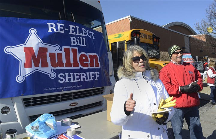 20170305lrdemocratsendorse07-6 Janie Vogel of Robinson flashes a thumbs-up as she stands outside the IBEW Hall on the South Side and campaigns for Sheriff Bill Mullen.