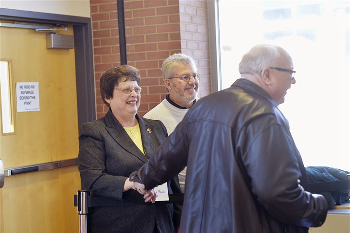 20170305lrdemocratsendorse03-3 City Council member Darlene Harris, left, who was seeking the Democratic Party's endorsement for the mayoral race, gets a quick shake of the hand from Steve Hladonik, a committeeman from the 17th ward.
