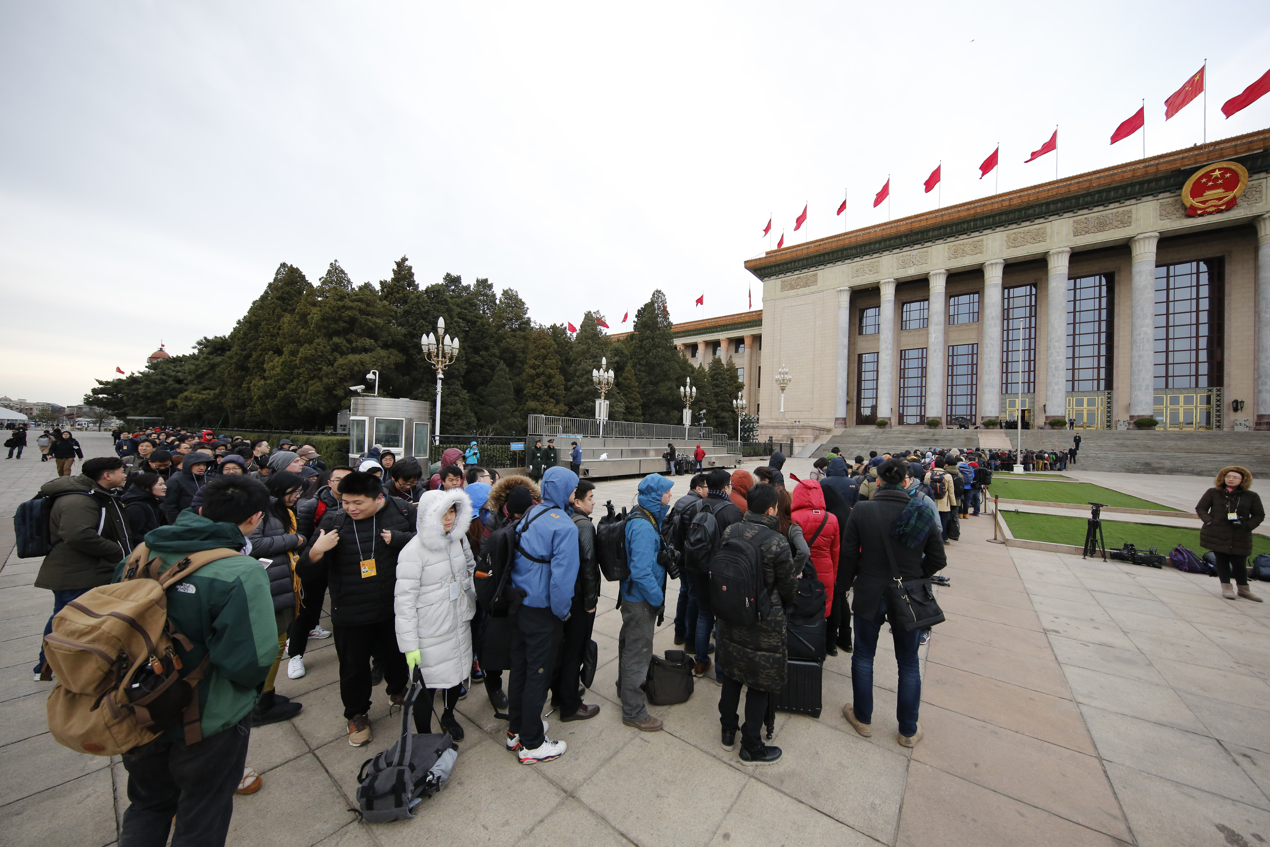China Politics Local and foreign journalists line up to enter the Great Hall of the People to cover the opening session of the annual National People's Congress in Beijing, Sunday, March 5, 2017. China's top leadership as well as thousands of delegates from around the country are gathered at the Chinese capital for the annual legislature meetings. (AP Photo/Andy Wong)