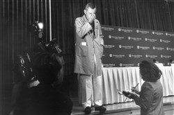 Dr. Thomas Starzl answers reporters' questions from the edge of the stage in June 1993, in Pittsburgh's Montifiore Hospital as he and two other transplant doctors, Dr. John Fung, and Dr. John Armitagbe briefed the press on the condition of then Pa. Governor Bob Casey.
