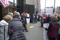 Demonstrators outside U.S. Senator Pat Toomey's new Downtown office in the Grant Building on March 7.