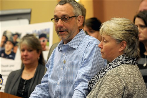 Jeff James and his wife Pam, right, of Frederick County, Md., are surrounded by extended family and close friends as they thank the search teams who helped look for their son Dakota during press conference at North Shore Hyatt Hotel on March 7.