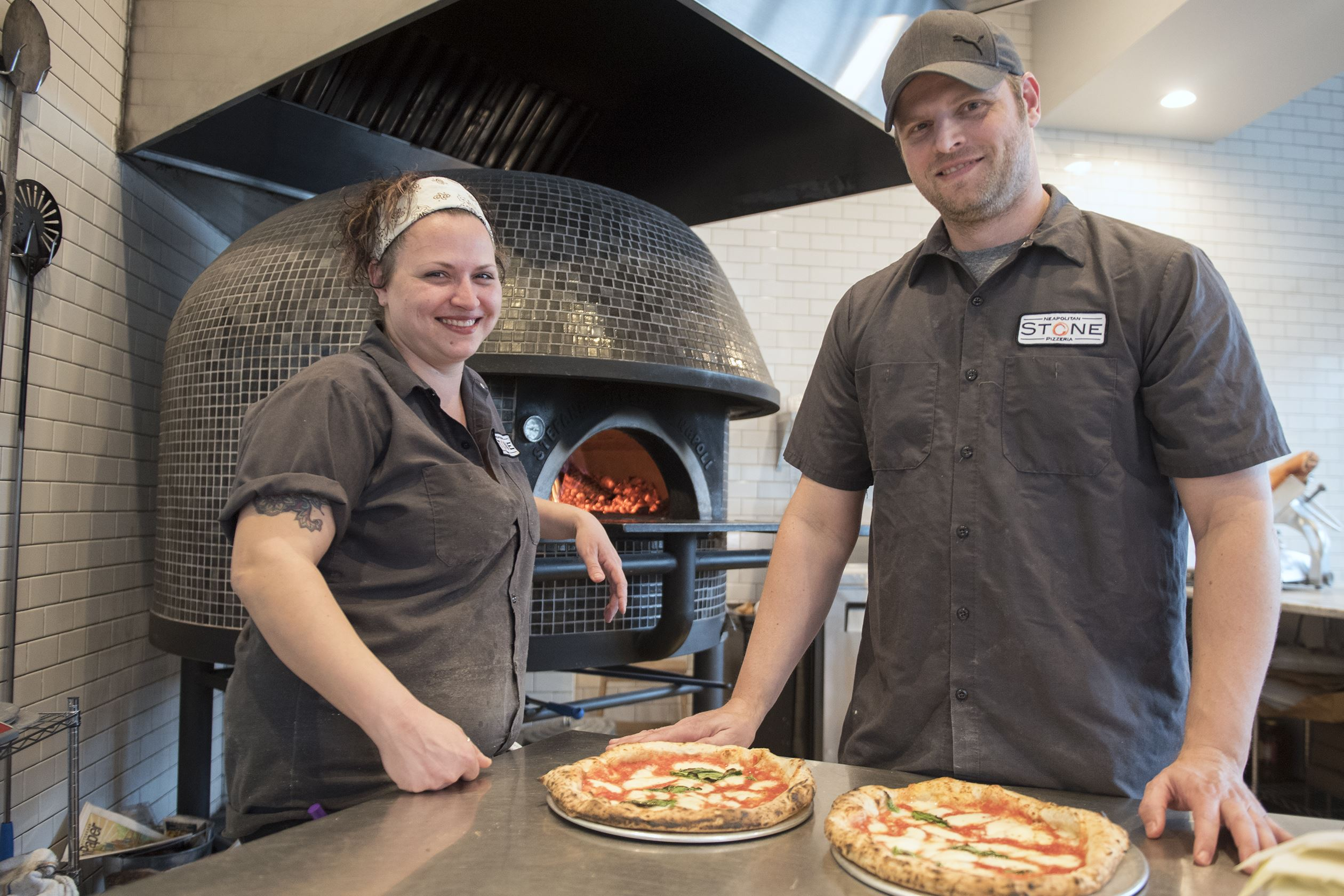 20170307hnPizza-7EDIT-6 Sibling duo Nicole and Rick Werner pose for a photo at their restaurant, Stone Neapolitan Pizzeria, Downtown. Rick formerly worked in corporate America for many years before undertaking a new career.