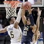 Georgia Tech guard Josh Okogie and forward Quinton Stephens, right, battle for a rebound against Pitt forward Sheldon Jeter during the second half Tuesday in the first round of the ACC tournament in New York.