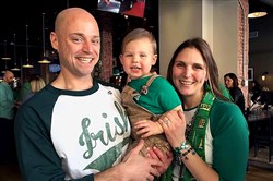 Matt Nee and his wife Lauren with son Dexter at their 2016 St. Patrick's Parade Day Party at Buford's, Uptown.