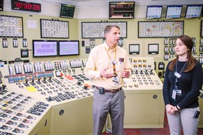Jim Krafty and Stacey Horvitz, resident inspectors for the U.S. Nuclear Regulatory Commission at the Beaver Valley nuclear power plant, explain the plant's simulator, which is a room that is a replica of the plant's control room.