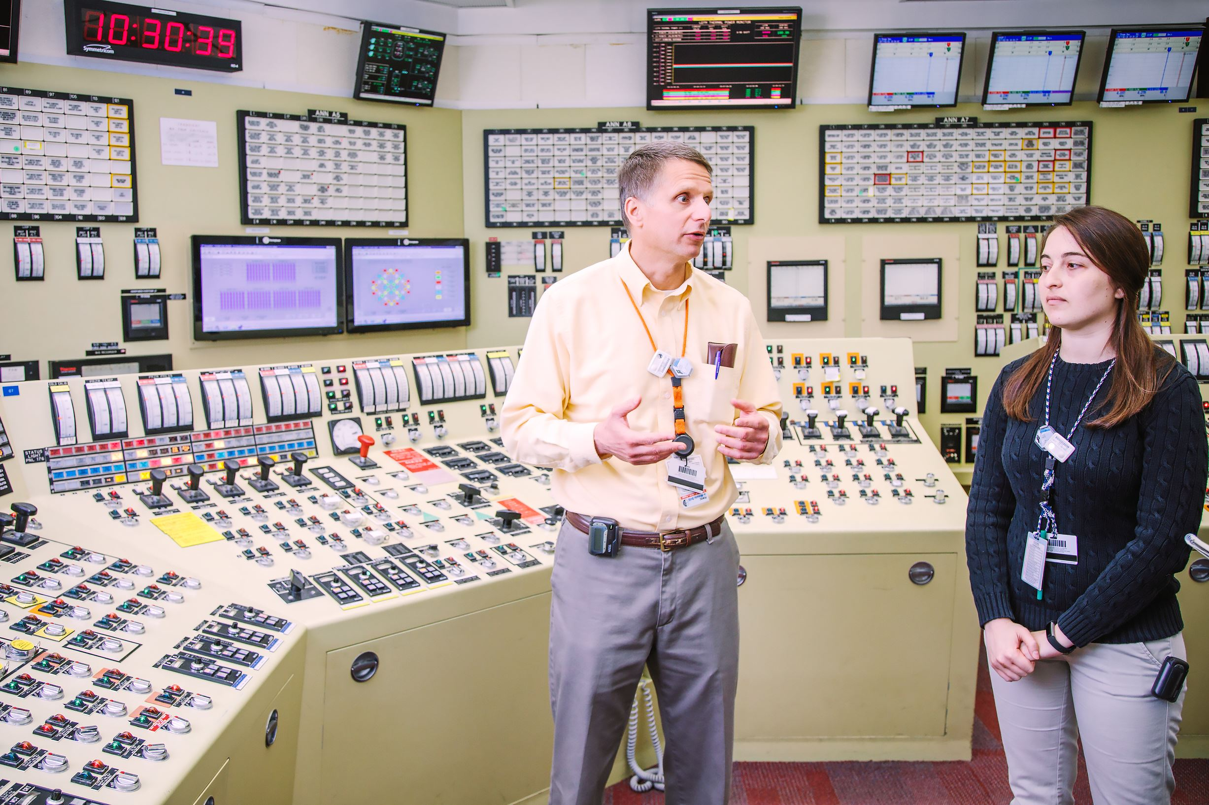 20170224arNuclearInspector03-2 Jim Krafty and Stacey Horvitz, resident inspectors for the U.S. Nuclear Regulatory Commission at the Beaver Valley nuclear power plant, explain the plant's simulator, which is a room that is a replica of the plant's control room.