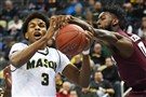 George Mason'sJustin Kier battles for a rebound with Fordham's Antwoine Anderson on Thursday.