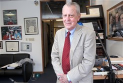 Thomas Starzl stands in his office on Fifth Avenue in Oakland in 2012.