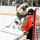 North Allegheny's Tyler Lamark shoots against Bethel Park at the Baierl Ice Complex  in Warrendale.