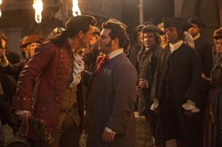 "Luke Evans, left, is Gaston and Josh Gad is LeFou in Disney's ""Beauty and the Beast,"" a live-action adaptation of the studio's animated classic directed by Bill Condon."