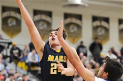 Mars' Robby Carmody goes up for a shot against Hampton in a PIAA playoff game Friday at North Allegheny.