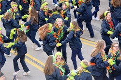 The Shovlin Academy of Irish Dance perform in the middle of the Boulevard of the Allies during the 2017 St. Patrick's Day parade.