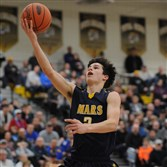 Mars' Cade Hetzler shoots a layup Friday against Hampton in the first round of the PIAA basketball tournament at North Allegheny. The PIAA has postponed all second-round games scheduled for Tuesday, including Mars' game against Erie Cathedral Prep at Sharon High School