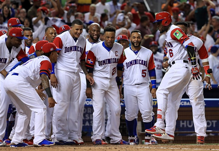 World Baseball Classic - Pool C - Game 4 - United States v Dominican Republic-9 Starling Marte is congratulated after hitting a solo home run during the eighth inning of a Pool C game of the 2017 World Baseball Classic against the United States.