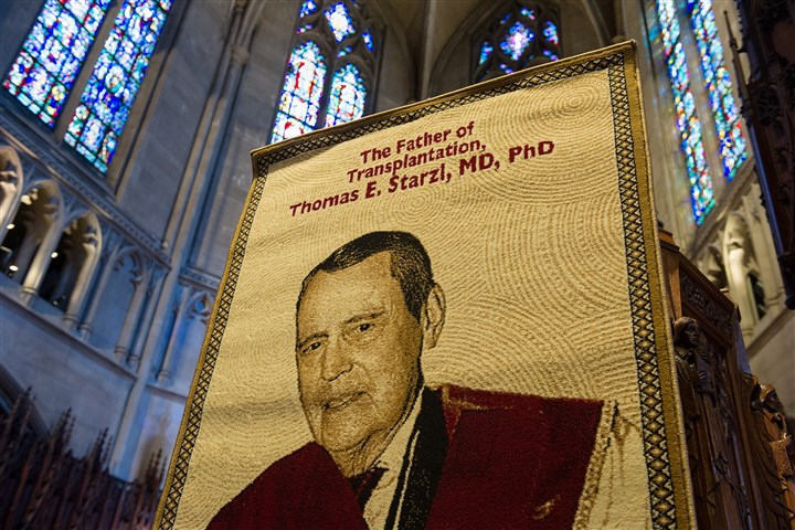 web20170311rldStarzlMemorial05-4 (Copy) A banner presented to Dr. Thomas Starzl for his 90th birthday last year stands at the front of Heinz Chapel before the start of his memorial service for on Saturday. Starzl, a pioneer in organ transplantation, died on March 4.