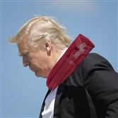 President Donald Trump's extra long red necktie is secured with transparent tape.